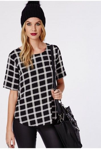 Get this lust-have mid sleeve crepe shell top to make sure you look mega this season. The monochrome check print with a high side hem split gives this top a sexy edge. Wear with an A line mini skirt and strappy heels for instant style succe...