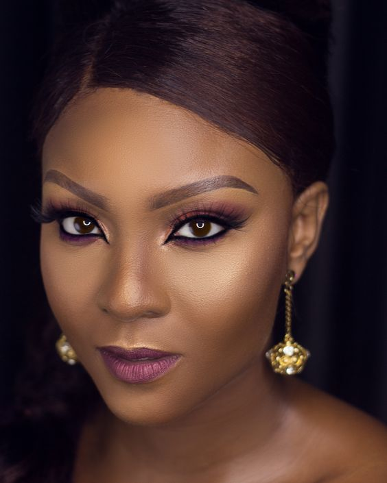 It Doesnt Get Any Chicer Than Osas Ighodaro-Ajibades Stylish Wrap Dress and Popping House of Tara Makeup