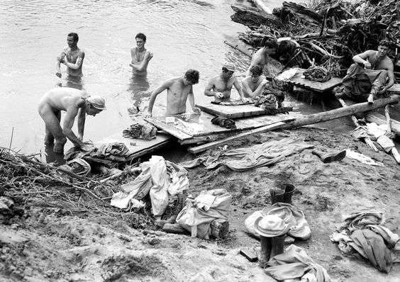 Near Buna, Papua New Guinea. 11 July 1944.American soldiers take a chance to wash their uniforms