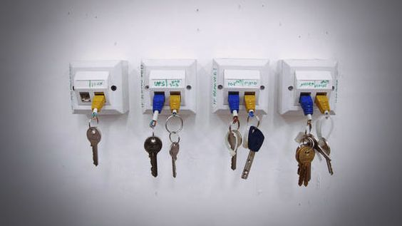 Plug your keys into the wall with a homemade Ethernet key chain and wall dock.