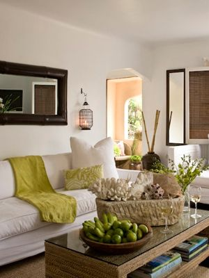 MIRROrLove again. Now, if I can get that coffee table built in reclaimed wood...-A living room that is as tranquil as a vacation; Airy white walls and furniture, accents of dark wood, and spots of green fresh flowers and fruit, creates a space that makes one feel like they are living in a retreat.: