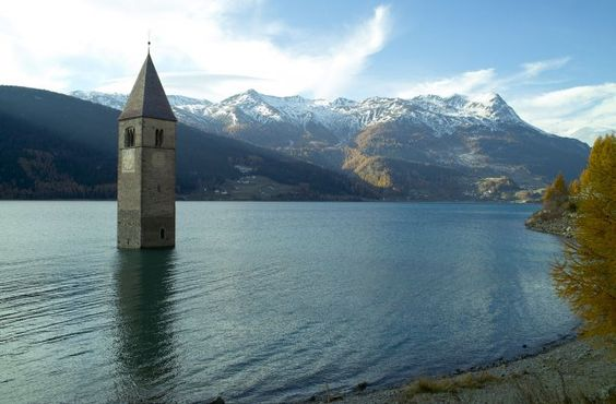Lake Reschen is famous for the steeple of a submerged 14th-century church; when the water freezes, this can be reached on foot. A legend says that during winter one can still hear church bells ring. In reality the bells were removed from the tower on July 18, 1950, a week before the demolition of the church nave and the creation of the lake.