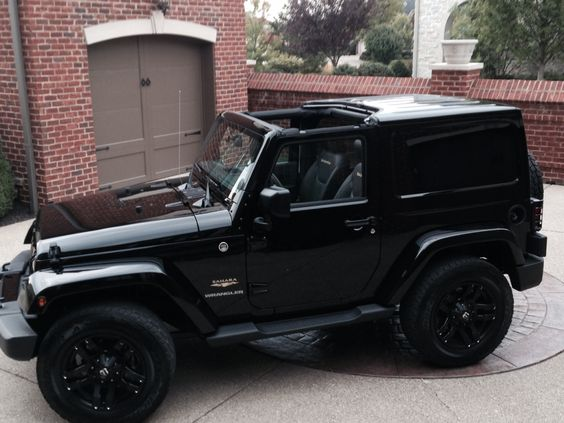 My new 2015 Jeep Wrangler Sahara. Customized a bit, special black bumpers, Pump Fuel Wheels, all chrome eliminated, 5 sets lights guards, black logo.