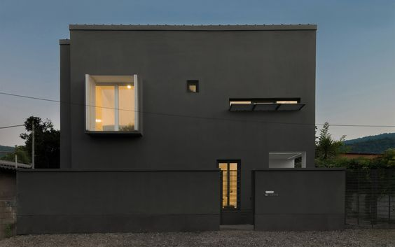 Iranian holiday home by RooyDaad Architects is black on the outside and white on the inside