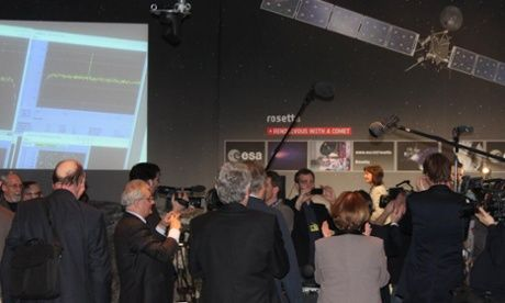 """Darmstadt, Germany. At 6.30 p.m. GMT on January 20, 2014, the long-awaited signal says that Rosetta has successfully come out of hibernation. You can see the spike in the spectrum shown on the screen. Mona Evans, """"Rosetta the Comet Chaser"""" http://www.bellaonline.com/articles/art182574.asp"""