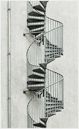 This is the coolest looking staircase I have ever seen. I really like how simple the concrete background is, and how elegant the stairs are. Wouldn't this be cool to have outside your house?