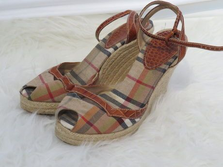Available @ TrendTrunk.com Burberry Sandals. By Burberry. Only $198.00!