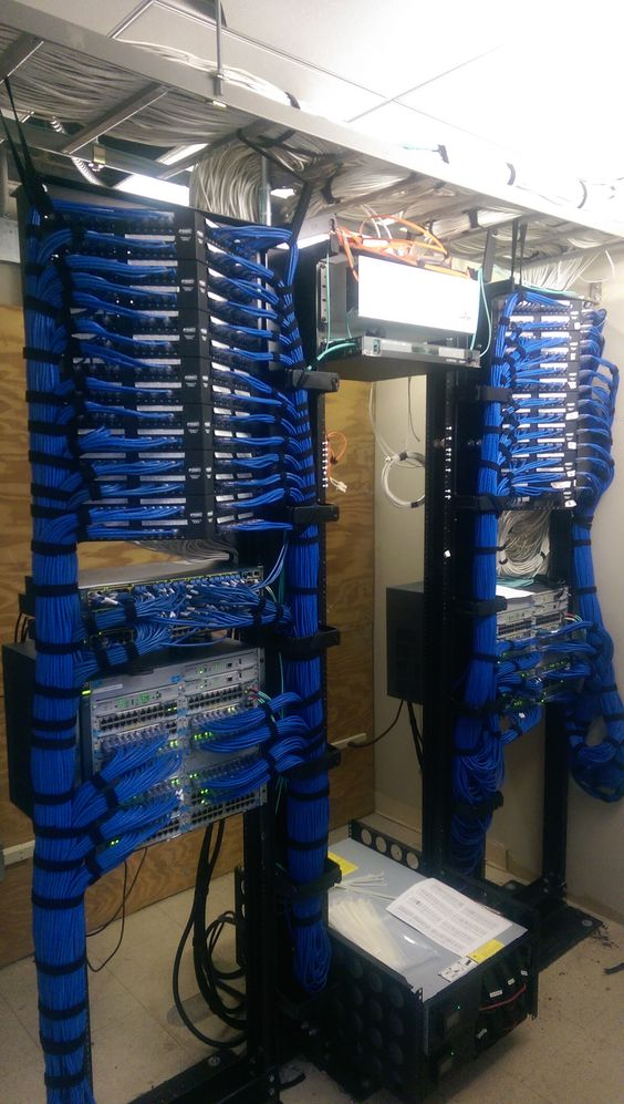 running a cisco switch cabinet into patch panels servers between the switch racks cable