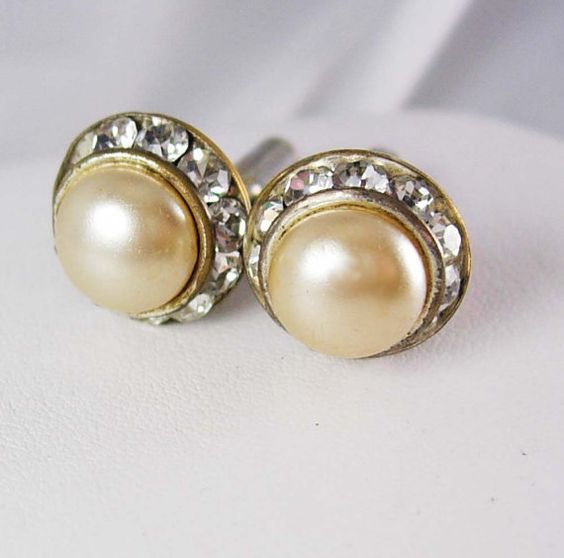 Vintage pearl Rhinestone wedding cufflinks ladies or man. A faux pearl is surrounded by vintage channel set crystal rhinestones that really