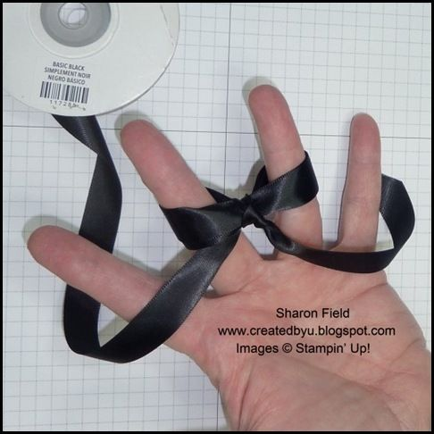 How to tie a double loop bow on your hand.