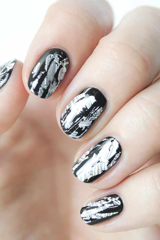 This stunning silver and black foil nail design is perfect for New Year's Eve. Here's how to get it.: