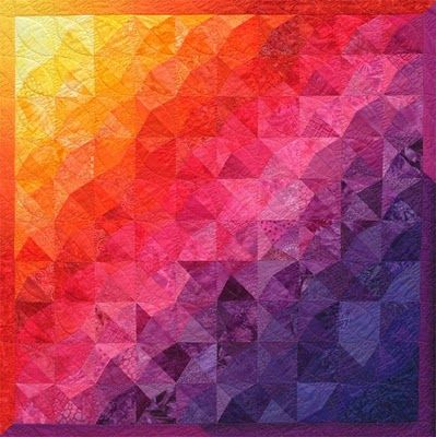 """Pizzazz"""" is a dazzling half-rainbow quilt.  There are NO curved pieces - only straight lines"""