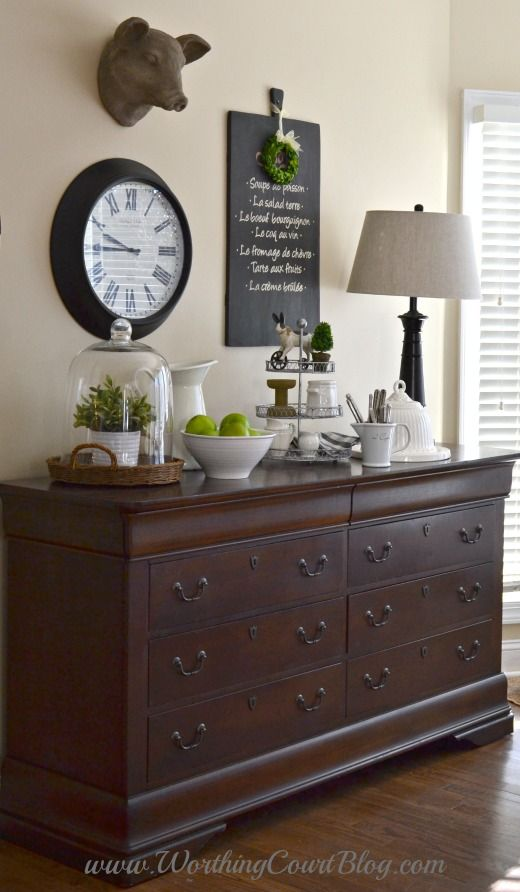 Use a dresser in the kitchen or dining room to store kitchen and table linens.  Make a great space to display favorite pretties too.