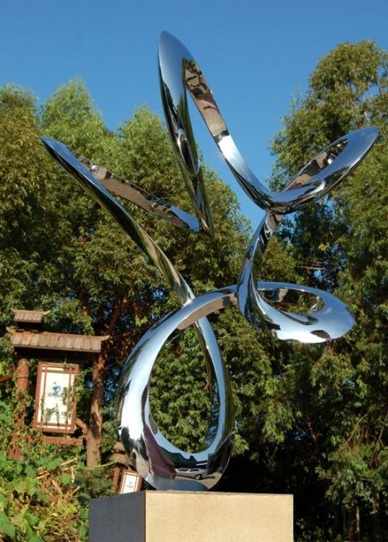 Stainless #steel Garden Or Yard / Outside and Outdoor #sculpture by #artist Wenqin Chen titled: 'Moving No.2 (stainless Steel Circular looping Minimalist garden statue)'. #art #sculptor #artwork #WenqinChen