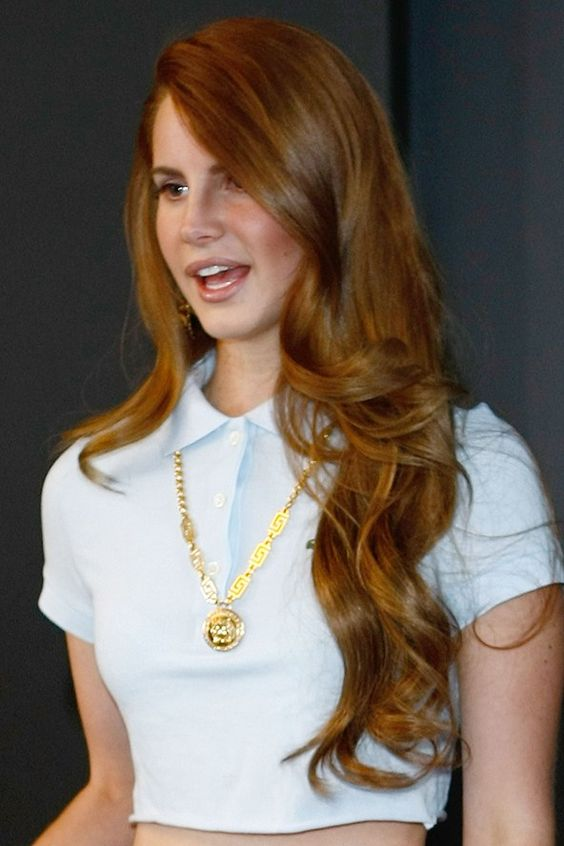 I would love to have these long loose curls...          (Lana Del Rey's long, side-swept curls - celebrity hair and hairstyles)