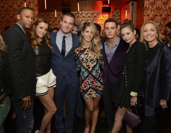 """The CW Network's 2013 Upfront Party at Finale in New York City on Thursday, May 16, 2013 – Pictured (L-R): David Ramsey, Katie Cassidy, Stephen Amell, Emily Bett Rickards, Colton Haynes, Willa Holland, and Susanna Thompson (""""Arrow"""") -- Photo: David Giesbrecht/The CW – © 2013 The CW Network, LLC. All rights reserved."""