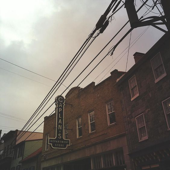 Something old something new. =============================== #downtown #historic #signs #brick #architecture #line #skyline #storefront #antique #clouds #mextures #mexturesapp