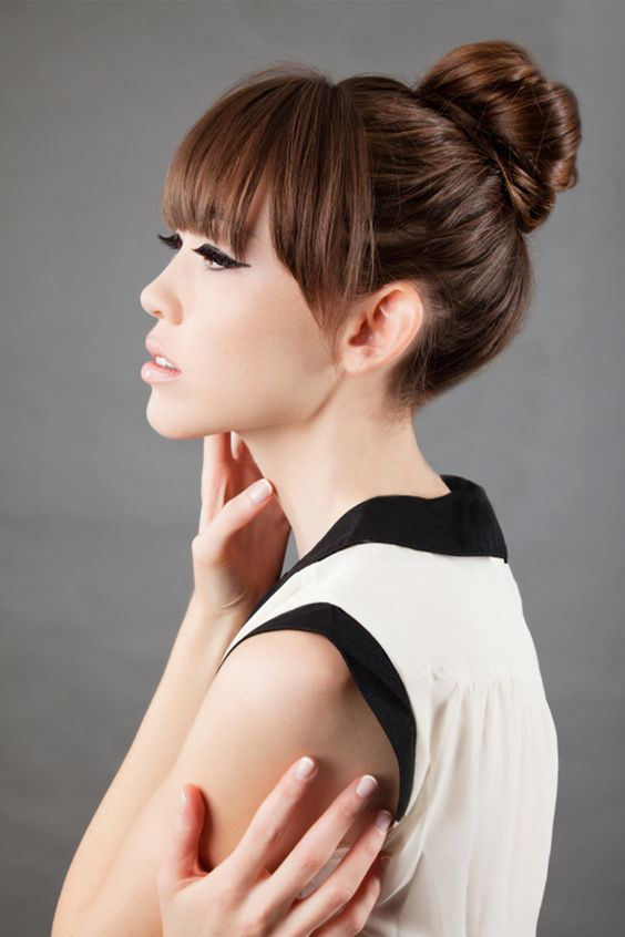 Straight across bangs and a ballerina bun. Rusk Celebrity Hair Stylist, Naz Kupelian's article on Fall hairstyle trends.
