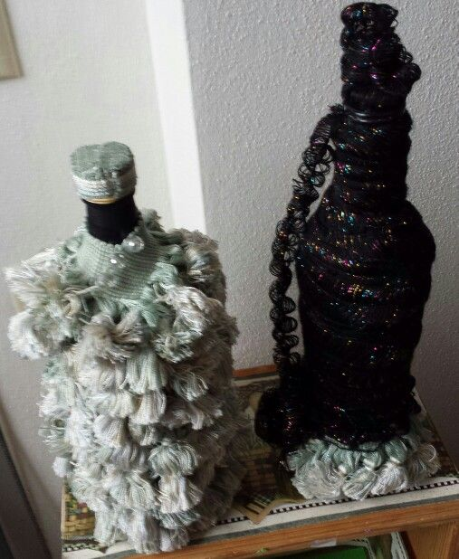DIY salvaged EVOO bottle, Juice bottle on right, ole.  Ready to party.  Tassle salvaged from Good Will.