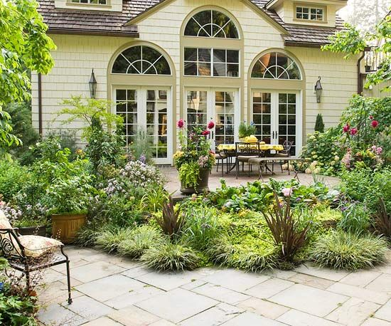 The perfect balance between texture and height, inserting a planting bed between two sections of a patio makes for extra pizzazz.