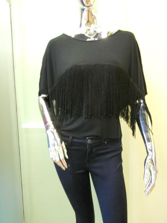 Our black fringe top paired with dark blue denim.