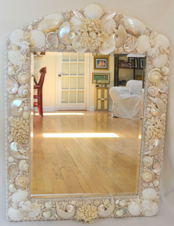 Arched mirror in white and cream polished and natural shells headed to Hawaii!  www.elegantshells.com