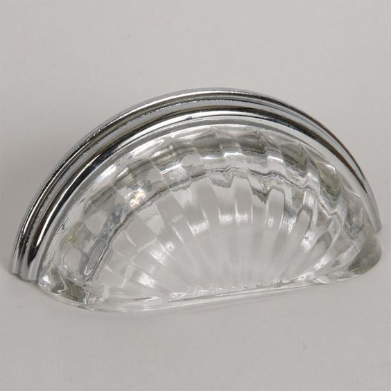 This transparent clear glass cabinet/drawer cup pull with melon design is part of the Melon Glass Bin Pull Series from Lew's Hardware. A hand poured glass bin pull with a polished chrome finish die cast zinc base. Perfect for use on cabinet doors and drawers capable of accepting a mounted pull, the melon glass design transforms the classic all metal fabrication into a unique transitional design with equal use within traditional and modern settings.