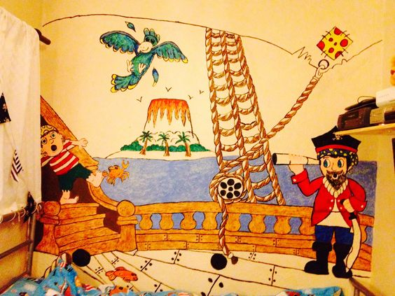 Pirate themed bedroom - I painted this on my grandsons bedroom wall and turned the bed into a ship