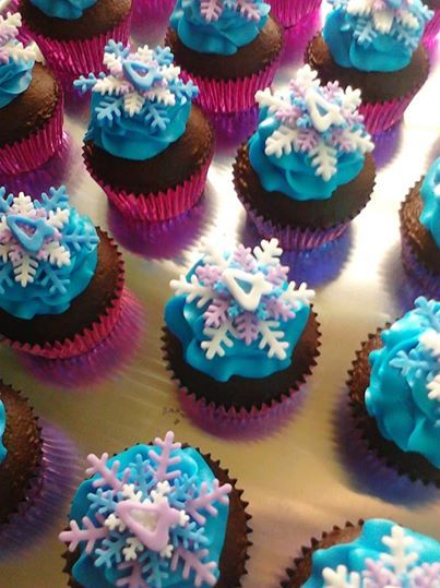 frozen theme cupcakes for Libby's birthday: white cupcakes with purple centers, blue icing and white and purple '3' and snowflakes