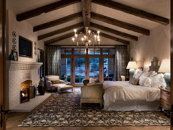 I love these vaulted ceilings and the open feeling of this, while still staying cozy with the fireplace. I would use brighter pops of color on a white base but stick to the cool end of the color spectrum to create a serene sanctuary.