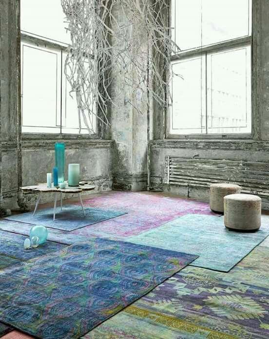 Layered rugs... Pastels....