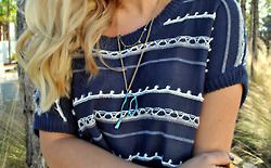 i love the navy and white top with the turquoise necklace.