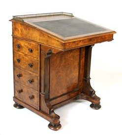A Victorian figured walnut Davenport, the slope top over four side drawers, stamped 'HOWARD & SONS BERNERS ST', with dummy opposing, resting on bun feet, 62cm wide.