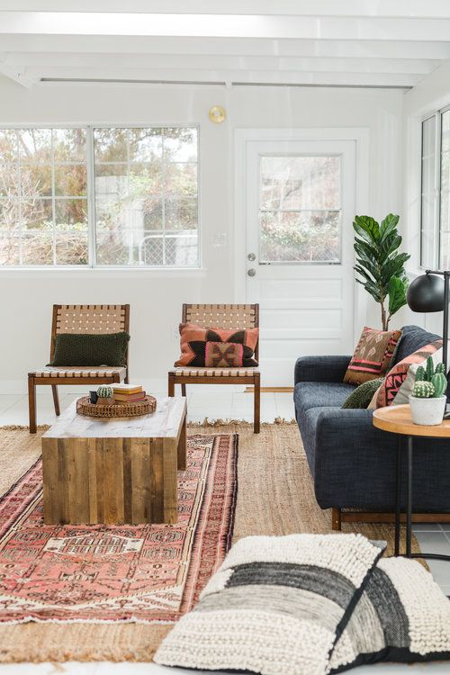 modern boho living room with persian rug, and leather woven ...