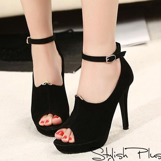 High heel black sandals with red nail polish for ladies
