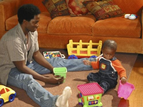 Michael juega con Walt baby