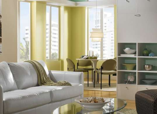 Yellow Living Room Ideas | Looking to brighten a dark room? Fail-safe tactics include hanging mirrors, decluttering, introducing greenery—and choosing pastel paint colors. The reflective hues bounce light back into the room making the space feel bigger, brighter, and airier.
