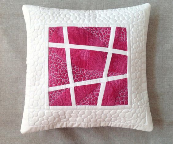 Pink pillow cover - pebbles free motion quilting: