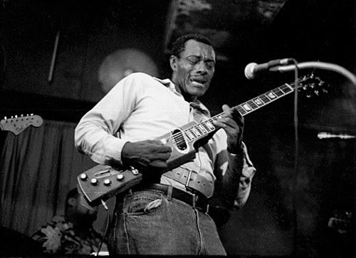 "Jimmy Spruill (June 9,1934 – February 15,1996) also known as Wild Jimmy Spruill, was a New York based session, blues and R & B guitarist. Later in his career, he took to playing a Gibson Les Paul which he ""modified"" by sawing off most of the body.  In New York, he worked steadily as a session sideman, appearing on many records in the 50's and 60's.  Note the unusual strap around him to hold the downsized Les Paul...."