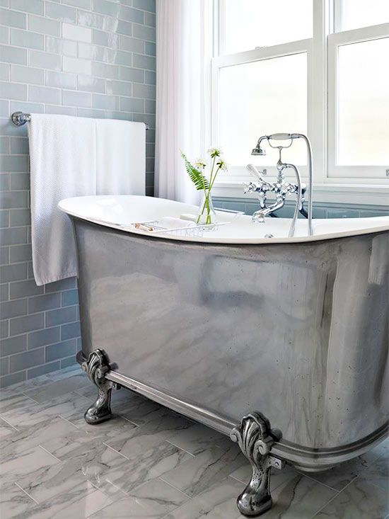 A Hint of Grandure. A stunning claw-foot tub is one of the few over-the-top amenities of the home.: