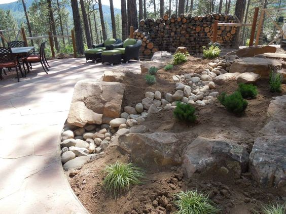 Durango colorado landscaping project with drainage swale for Landscape drainage design