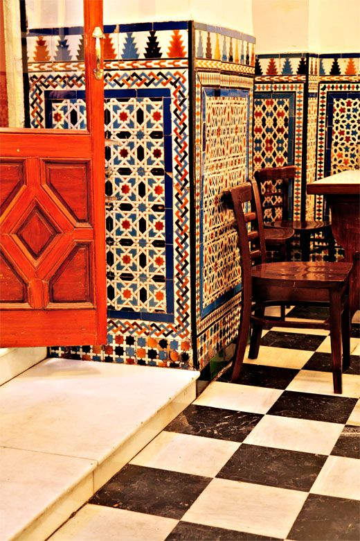 Geometric patterns decorate the entrance to a bar in Seville, recalling the influence of eight centuries of Islamic rule in Spain. Photo ©Mike Randolph