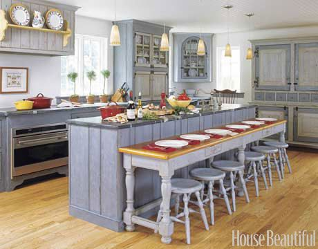 Perfect for a big family. :) Swedish style inspired kitchen. ......Designed by Kevin Ritter. housebeautiful.com #cabinets #kitchen_cabinets #island #bar_stools