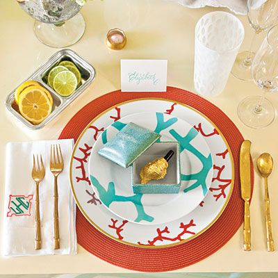 Bring In the Beach | Repeated use of bamboo and coral incorporates beachy motifs into the table setting. The sophisticated color scheme of turquoise, gold, and coral keeps it from looking overly themed.