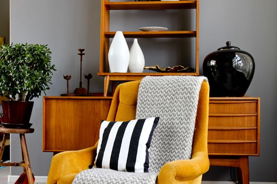 danish teak sideboard, vintage vases and yellow lounge chair at Boris Zbikowski's apartment