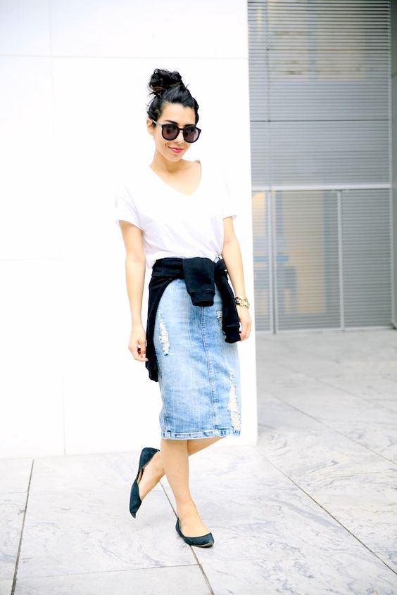 Distressed denim pencil skirt. 90's grunge shirt tied around the waist...