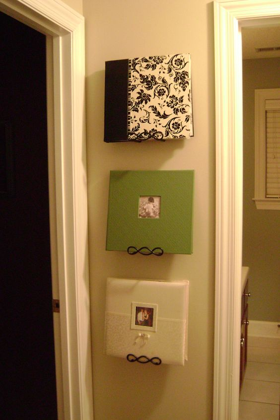 photo albums displayed on plate hangers; great way to display the albums that would normally sit on a bookshelf unseen