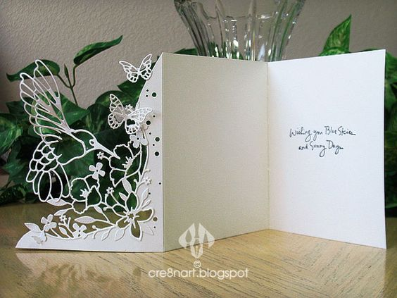 All-white card, made with Memory Box 'Wildflower Corner' and Cheery Lynn 'Lace Hummingbird', by cre8nart. Also uses Tim Holtz 'Woodgrain' EF and Inkadinkado stamp.: