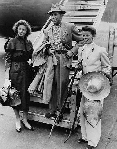 Lauren Bacall, Humphrey Bogart and Katharine Hepburn arrive in Africa to begin filming The African Queen