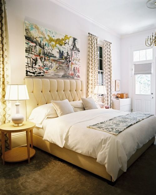 tufted headboard + gorgeous art. creamy and cozy.